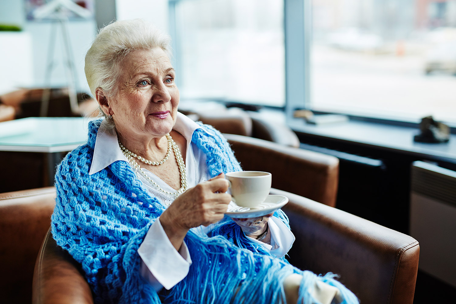 elder woman enjoying a nice warm cup of coffee